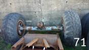Oś od przyczepy HW 8011 z kołami (balonowymi) i hamulcem.
